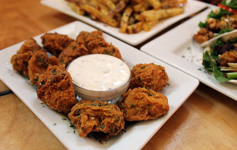 """The """"Shrooms"""" are a great appetizer of mushroom poppers with homemade ranch dressing. It costs $5. - LEXIE MILLER"""