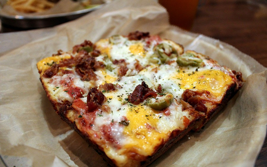 The Canadians pizza with bacon, cheese curds and green olives costs $11. - LEXIE MILLER