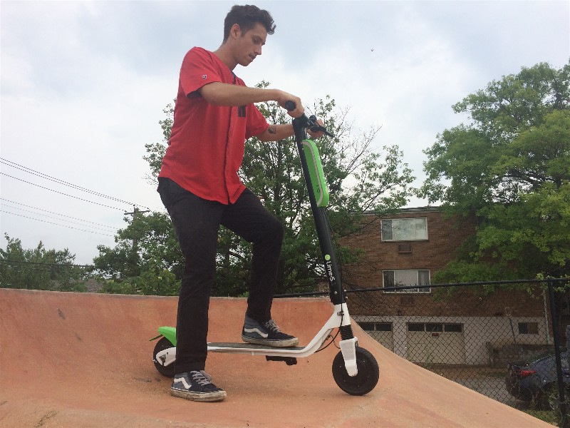 """Fridge"" gets ready to test-ride a scooter at the skate park."