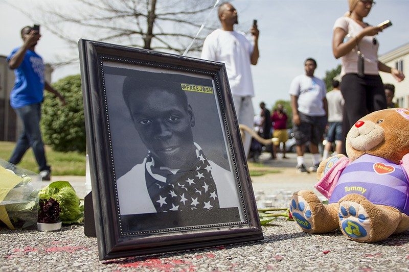 Protester Josh Williams' portrait had a place at Michael Brown's memorial. - DANNY WICENTOWSKI