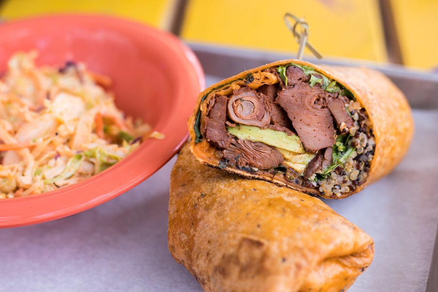 The veggie wrap is stuffed with cherry-smoked jackfruit, avocado, Brussels sprouts and cotija cheese. - MABEL SUEN