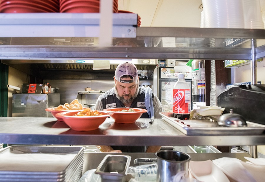 Chris Delgado in the kitchen. - MABEL SUEN