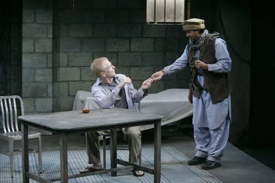 John Hickok as Nick and Ahmed Hassan as Dar.