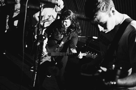 Doom Town's Ashley Hohman and Ben Smith (foreground) during their recent European tour.
