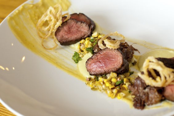 Dos Carnes: Seared hanger steak, braised beef cheek, corn, shallots and potatoes.