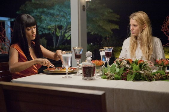 Salma Hayek dines with her prisoner, O (Blake Lively), in Savages, the thriller from filmmaker Oliver Stone.
