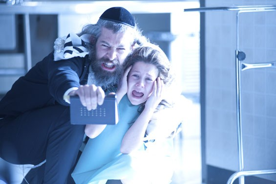 Matisyahu and Natasha Calis battle the dybbuk in The Possession.