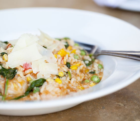 Risotto Del Giorno - a roasted Georgia corn, sweet red bell pepper puree, English Peas, baby arugula, shrimp, and shaved parmigiano risotto