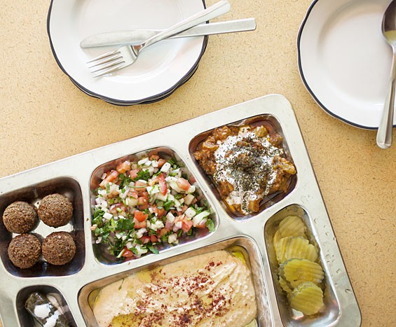 "Sameem's ""Mediterranean Feast"" includes falafel, eggplant-stuffed grape leaves, hummus and shirazi salad. Go here for more photos from Sameem Afghan Restaurant."