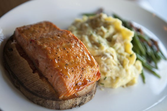 Maple-plank bourbon salmon dinner, served with Yukon smashed potatoes and green beans with pecans. See more photos of J. Gilbert's here.