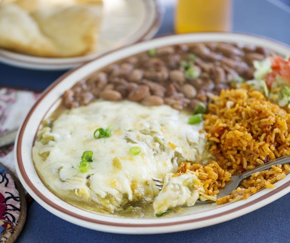 Green Chile Enchiladas - stacked corn tortillas with Monterrey jack and green chile. Add chicken, beef, chorizo, veggie chorizo or calabacitas. Comes served with pinto beans and rice. See more photos of Southwest Diner here