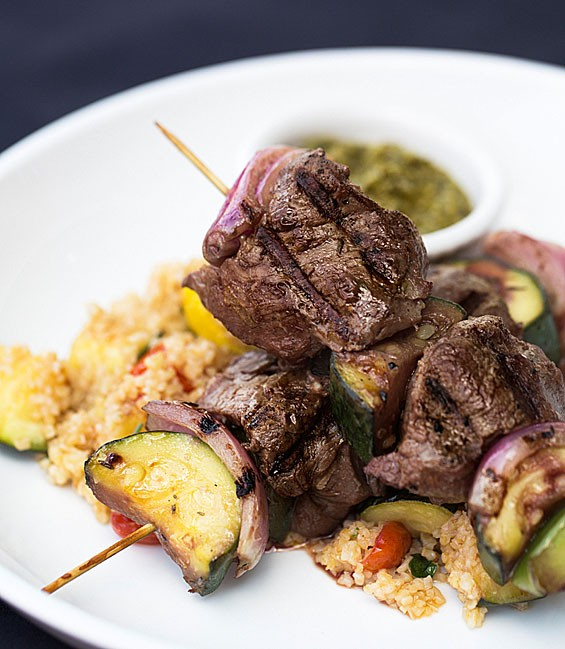 J Greene's eight-ounce beef tenderloin kabobs come grilled with squash, zucchini, onions, peppers, warm tabouleh salad and chimichurri sauce. See also: Inside J Greene's Pub.