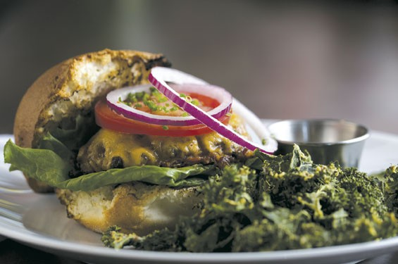 A locally sourced grass-fed beef burger topped with cheddar cheese, lettuce, tomato, red onion, chive aioli and kale chips. See photos: Athlete Eats Serves Healthier Options on Cherokee Street