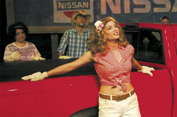 "In New Line Theatre's latest, Taylor Pietz as Heather Stovall sings ""If I Had This Truck."" In the background are Anna Skidis as Norma Valverde and Todd Schaefer as JD Drew."