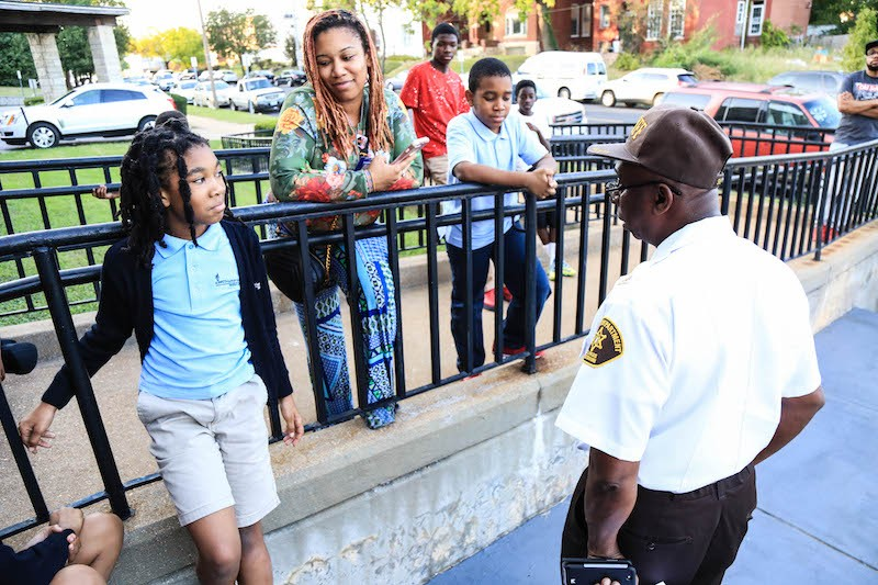 Residents gather for the Vandeventer neighborhood's National Night Out party — which included a presentation on a new business district. - NICHOLAS COULTER