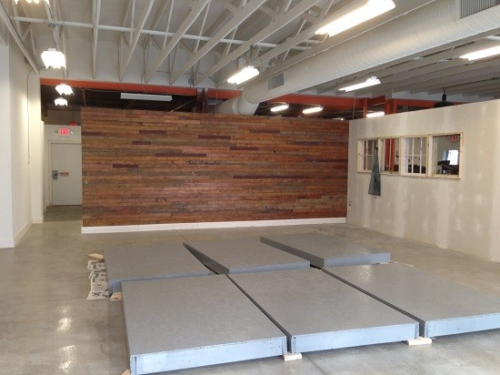 A stage under construction in the events space to be shared by Firecracker and Central Print.