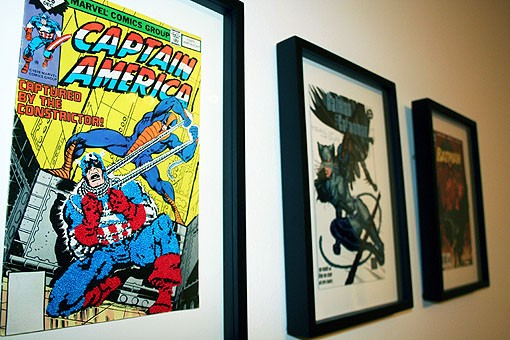 The covers are put together in sets of three, so people can see the details that can be found in the comic book covers. - PHOTO: EMILY GOOD