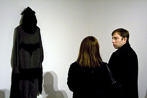 People enjoyed having the chance to see a lifesize costume of their favorite super-heroes and lingered at the ones they seemed to enjoy the most, such as Batman. - PHOTO: EMILY GOOD