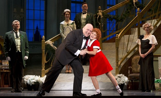 Gilgamesh Taggett as Daddy Warbucks and Issie Swickle as the title character in Annie. - COURTESY FABULOUS FOX THEATRE