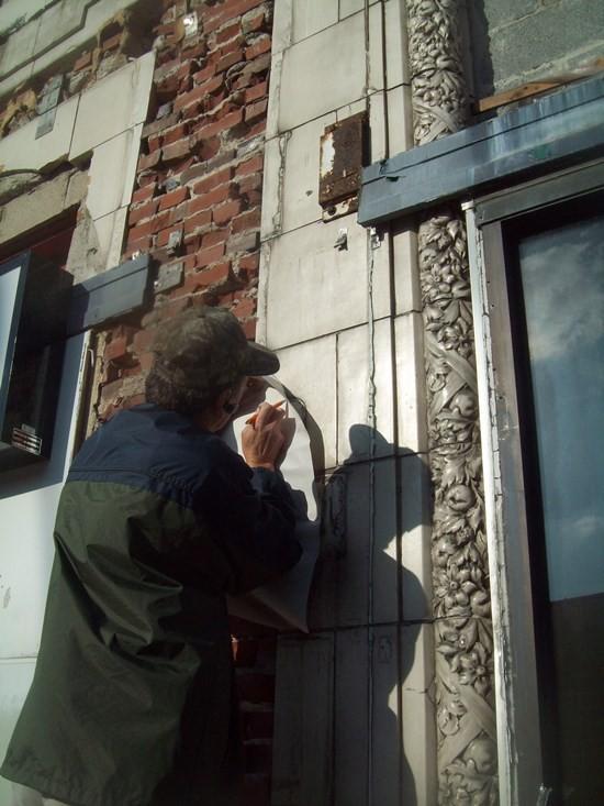 Andrey Gura makes a cast of original terrac otta on the Cinderella Building. - PHOTO COURTESY OF MELINDA STEWART AND WILL LIEBERMANN