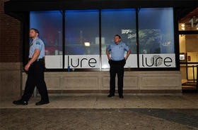 Off-duty cops watching Lure's entrance - PHOTO BY JASON STOFF