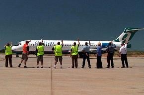 "Airport employees practice the ""Branson Wave."""