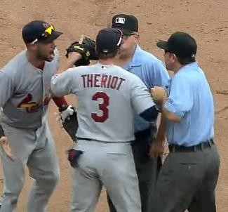 Theriot gets into it with umpires yesterday in Cincinnati. - MLB.COM