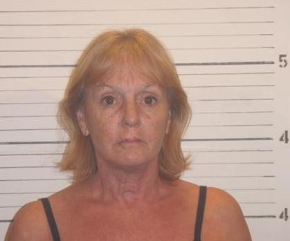 Prosecutors say Donna MrKacek covered up the murder of her young lover.