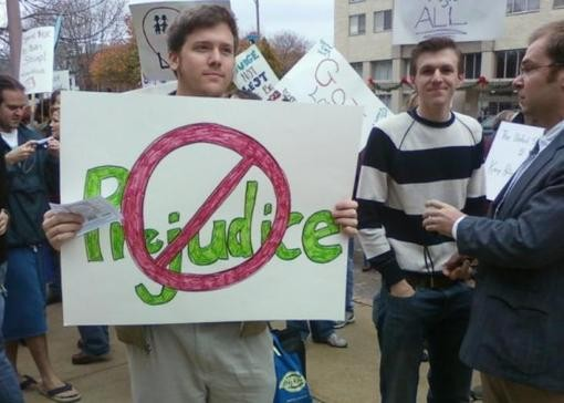 Burns (holding sign), O'Keefe (striped shirt) and Basel (in the suit) infiltrated a St. Louis gay-rights rally last fall. - STLACTIVISTHUB.BLOGSPOT.COM