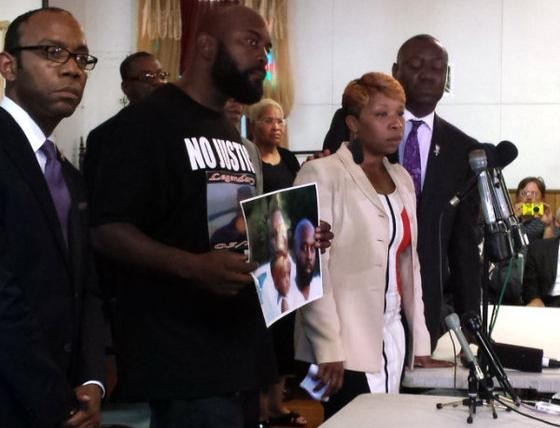 The parents of Michael Brown (center) with attorney Benjamin Crump (right) at a news conference last week. - JESSICA LUSSENHOP