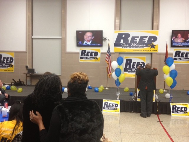 Reed supporters watch Slay's victory speech live. - SAM LEVIN