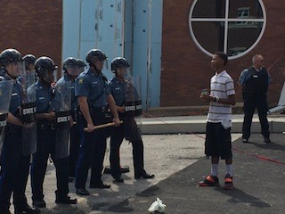 Davion Lorich asks police officers if they feel bad about what happened. - PHOTOS BY MITCH RYALS