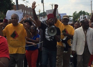 Marchers on South Florissant Road Monday morning continue to protest Michael Brown's death. - PHOTOS BY MITCH RYALS