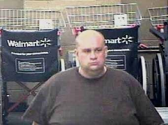 """Police describe the suspect as """"heavy set"""" and bald with some bad tattoos on his forearm."""