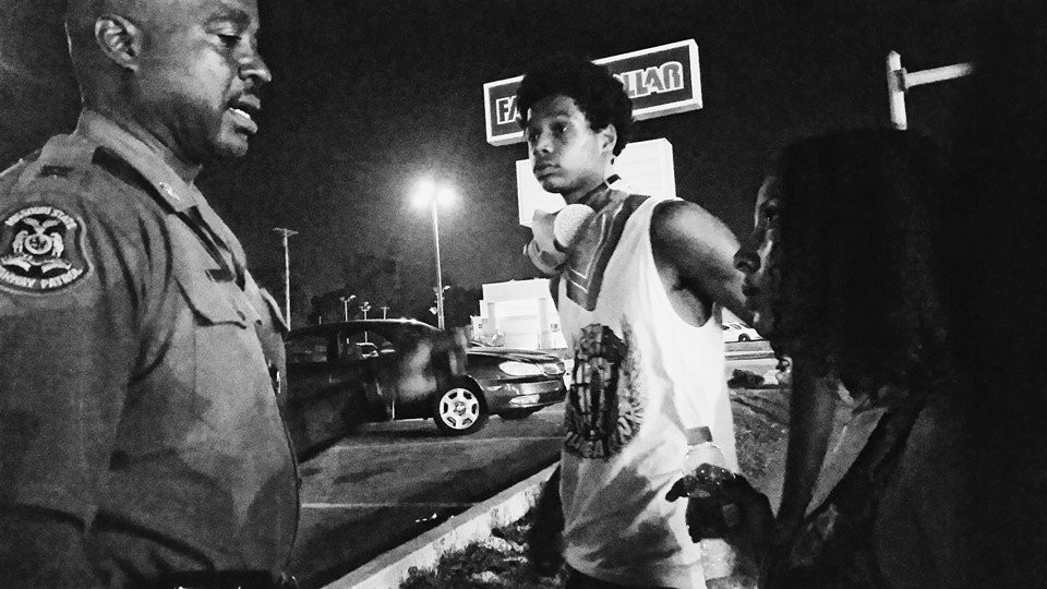 Colón and a member of the Lost Voices talk to Captain Ron Johnson during the Ferguson protests. - RASHIDA KHANBEY
