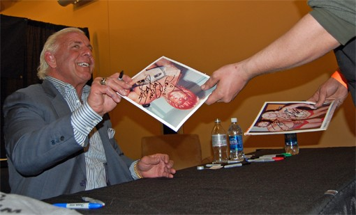 Ric Flair will sign a photograph of himself covered in blood for $30. Smiles are free.