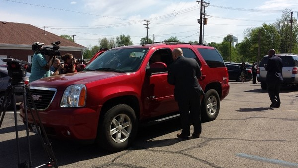 Mike Anderson and his family drive away from jail (and reporters). - JESSICA LUSSENHOP