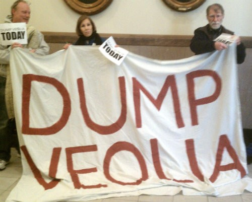Activists hold banners in the hallway outside of Mayor Francis Slay's office. - JESSICA LUSSENHOP