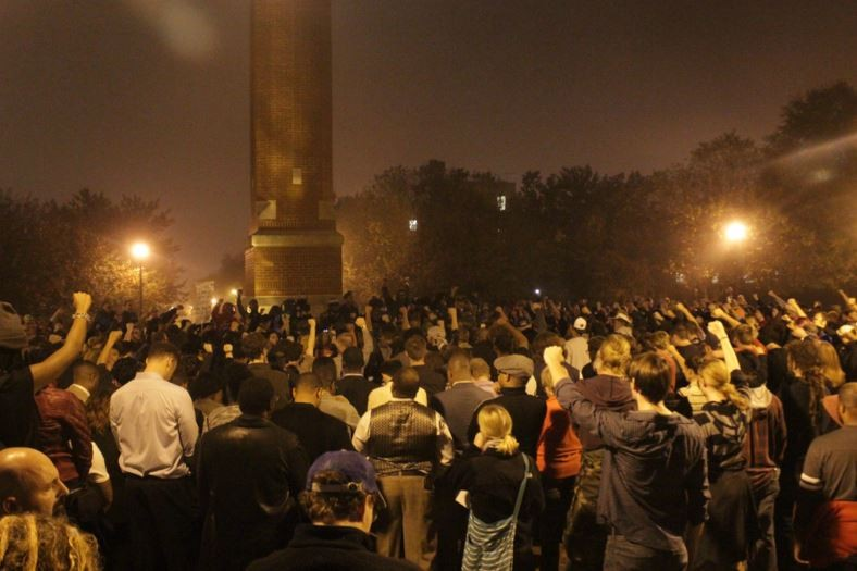 Hundreds of protesters swarm the Saint Louis University campus. - DANNY WICENTOWSKI