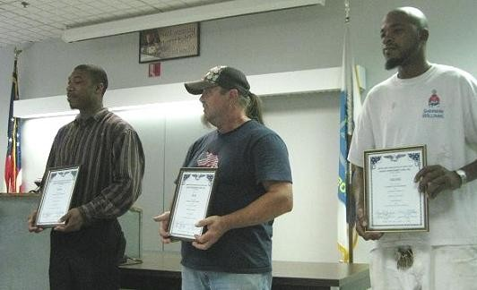 Darrell Wallace, Terry Kennedy and Timothy Peterson accept awards Wednesday.