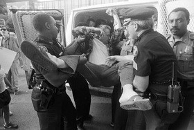 An anti-abortion protester gets carried into the paddy wagon at a protest in Atlanta. - IMAGE VIA