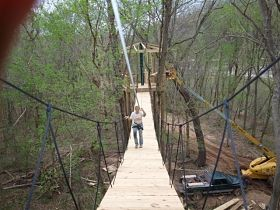 A worker puts the finishing touches on the Caveman Zipline. - COURTESY OF MERAMEC CAVERNS