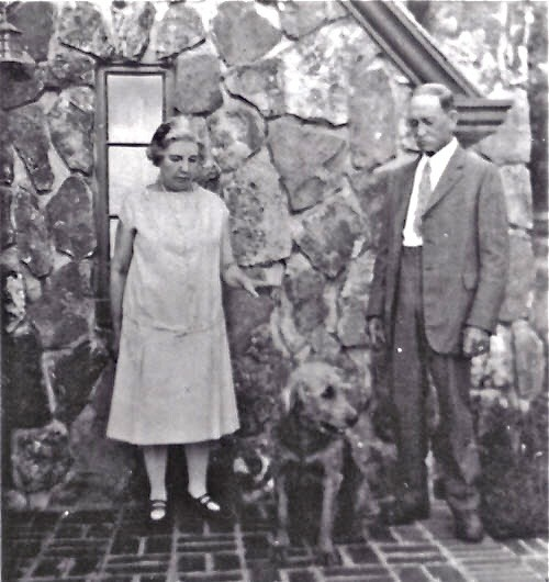 Laura Ingalls Wilder, her husband Almanzo and their dog Nero at Rocky Ridge Farm in Mansfield, Missouri, in the early 1930s, when Laura was writing the Little House books. - IMAGE VIA