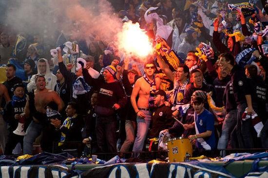 Bosnians light flares during a friendly match at Busch Stadium. - JOHN GITCHOFF