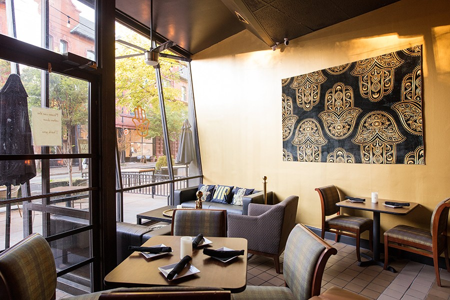 The restaurant includes a lounge and a spacious patio with sidewalk seating. - MABEL SUEN
