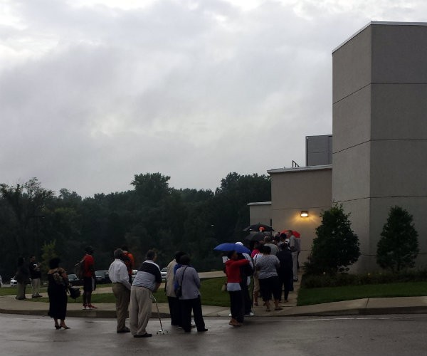 The line began forming well before the 7 p.m. starting time. - JESSICA LUSSENHOP