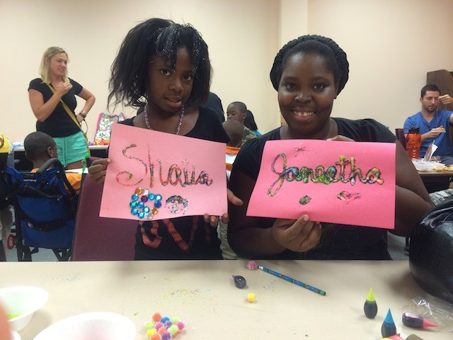 Shaila and Janeatha Evans show off their art projects at the Ferguson Public Library. - PHOTO BY MITCH RYALS