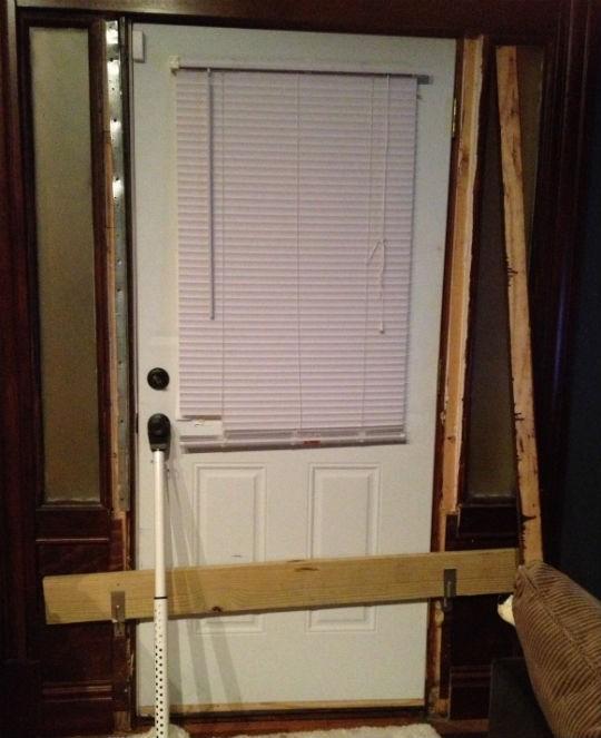 Her door after a break-in.