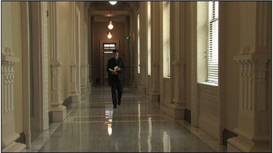 A scene from Casualties of the State. Actor Alex McCormick plays National Security Agency analyst Lucien Archer. The Old Post Office plays the Eisenhower Executive Office Building. - COURTESY CORNER FILM PRODUCTIONS