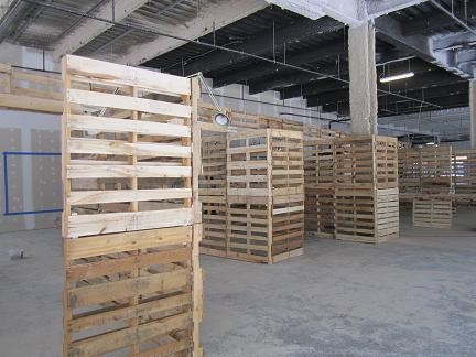 The exhibit wasn't hung when Daily RFT visited Wednesday. But imagine these pallets displaying architectural renderings, and you get the idea.